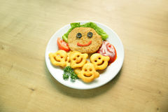 Schnitzel and garnish on a dish. In a children's restaurant Royalty Free Stock Photography