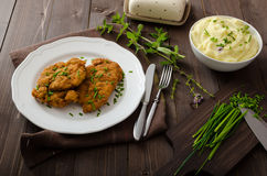 Schnitzel with herbs,. Mashed potatoes and chives Royalty Free Stock Image