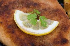 Schnitzel with lemon macro Royalty Free Stock Photography