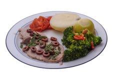 Schnitzel-Mahlzeit gegen einen weißen Hintergrund lizenzfreies stockbild