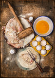 Schnitzel making, preparation composing with ingredients: meat, flour, eggs, crumbs. On wooden background, top view Royalty Free Stock Photo