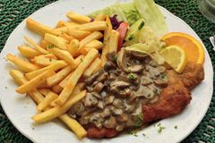 Schnitzel with mushroom sauce. In Europe Stock Photography