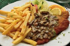 Schnitzel with mushroom sauce. In Germany Stock Images