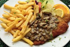 Schnitzel with mushroom sauce. In Germany Royalty Free Stock Photo
