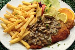 Schnitzel with mushroom sauce. In Germany Stock Photo