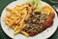 Schnitzel with mushroom sauce Stock Photos