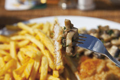 Schnitzel with mushrooms and chips royalty free stock images