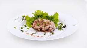 Schnitzel on a plate. Schnitzel with lettuce on a white plate Stock Image
