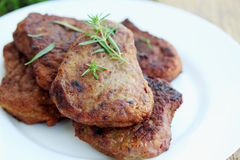 Schnitzel. Pork schnitzel with fresh savory on plate Stock Images