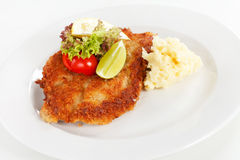 Schnitzel with potatoes Stock Photography
