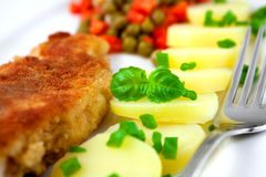 Schnitzel with potatoes,peas and carrot Stock Images