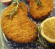 Schnitzel restaurant fried meat meats coated with flourin oil stock photo