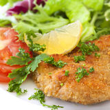 Schnitzel with Salad. Garnished with lemon and parsley Stock Photo