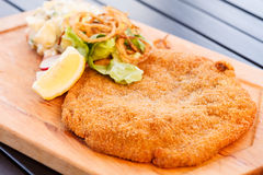 Schnitzel with salad. On table Royalty Free Stock Images