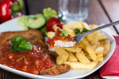 Schnitzel with Sauce. Fresh made Schnitzel with Sauce and Chips Stock Photography