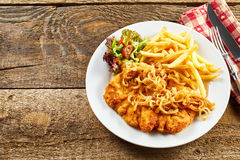 Schnitzel served on rustic table royalty free stock photo