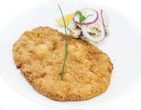 Schnitzel. Vegetable salad at restaurant Stock Image
