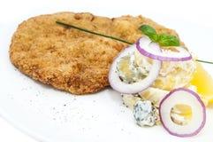 Schnitzel. Vegetable salad at restaurant Stock Images