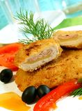 Schnitzel and vegetables on white plate stock photos