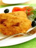 Schnitzel and vegetables on white plate Royalty Free Stock Image