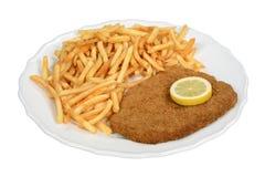 Schnitzel. Viennese escalope schnitzel with fries Stock Photo