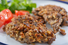 Schnitzel with walnuts Stock Photos