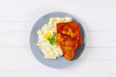 Schnitzels with potato salad Stock Images