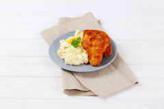 Schnitzels with potato salad Stock Photography
