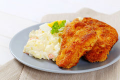 Schnitzels with potato salad Royalty Free Stock Photography