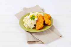 Schnitzels with potato salad Royalty Free Stock Images