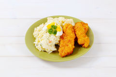 Schnitzels with potato salad Stock Photos