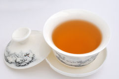 Schnitzen von Teecup und von Tee Stockbild