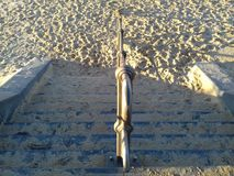 Schodki znikają w piasku Obrazy Stock