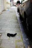 Schoen op de weg Stock Foto