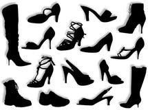 Schoenen en laarzensilhouetten Stock Foto's