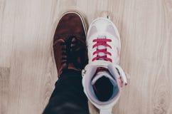 Schoenen en rolschaatsen royalty-vrije stock afbeelding