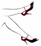 Schoenen op de contour van de vrouwelijke voeten Stock Foto