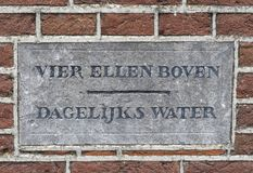 Water Level Schokland. Schokland, Netherlands, June 23, 2018: water level stone in church of former island Schokland, UNESCO world heritage site, in Flevoland royalty free stock photography