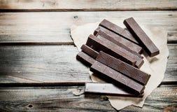 Schokolade auf Papier lizenzfreie stockfotografie