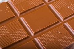 Schokolade auf weißem Hintergrund Lizenzfreie Stockbilder