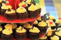 Schokolade capcakes Hintergrund lizenzfreie stockbilder