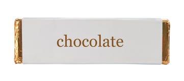 Schokolade, die Aluminiumfolie und Papier einwickelt Stockfoto