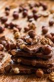 Schokolade und Muttern Stockfotos
