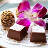 Schokolade und Orchidee in Prag lizenzfreie stockfotografie
