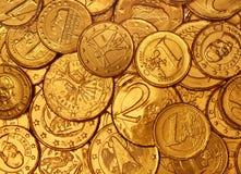 Schokoladen-Goldmünze-Hintergrund Lizenzfreie Stockbilder
