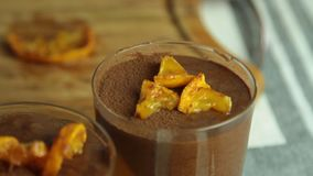 Schokoladencreme mit orange Gelee stock footage