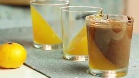 Schokoladencreme mit orange Gelee stock video footage