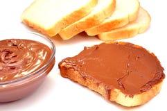 Schokoladencreme und -toast Lizenzfreie Stockbilder