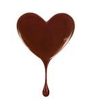 Schokoladenfleck in Form von Herzen mit fallendem Tropfen stockfoto