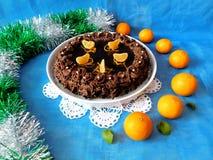 Schokoladenkäsekuchen verziert mit Mandarinen Lizenzfreie Stockbilder